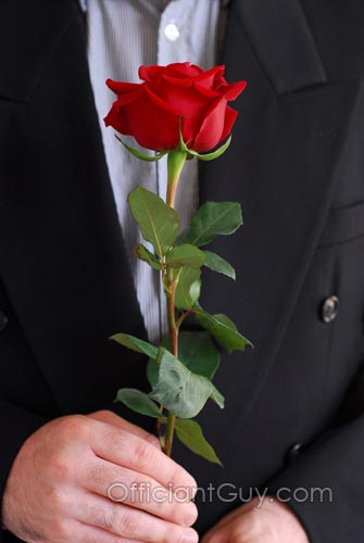 groom holding a rose during a rose ceremony during Southern California weddings