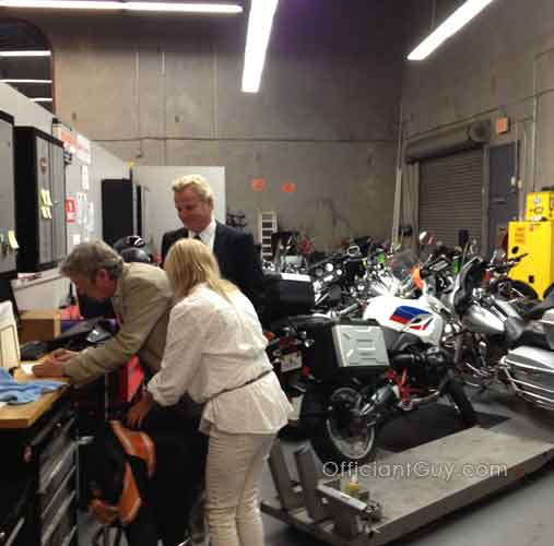 filling out the marriage license before a motorcycle wedding