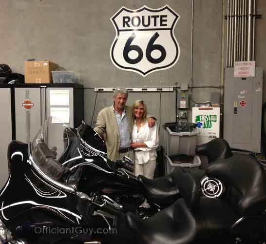 the motorcycle wedding couple under the Route 66 sign