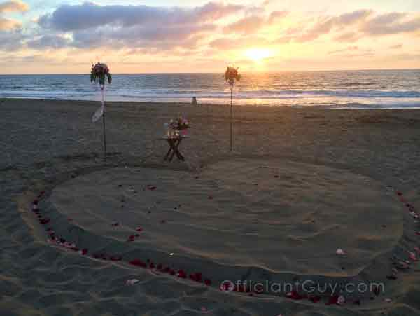 A heart on the beach photographed LA wedding officiant Chris Robinson