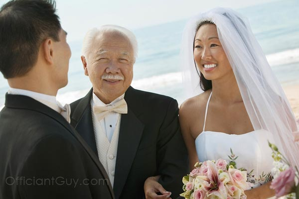 father giving away his daughter during her wedding